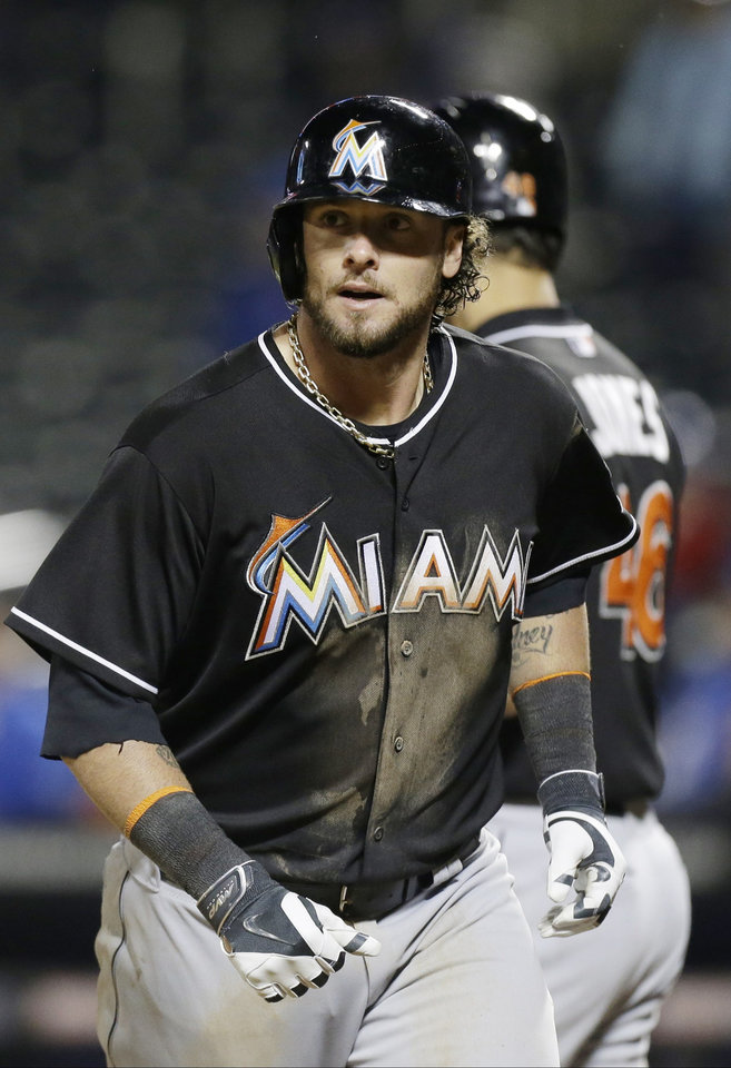 Photo - Miami Marlins' Jarrod Saltalamacchia heads back to the dugout after hitting a home run during the 10th inning of a baseball game against the New York Mets on Saturday, April 26, 2014, in New York. The Marlins won 7-6. (AP Photo/Frank Franklin II)