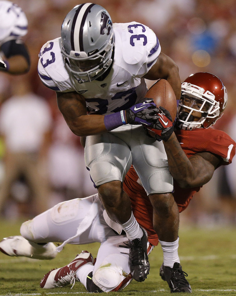 Oklahoma\'s Tony Jefferson (1) tries to bring down Kansas State\'s John Hubert (33) during a college football game between the University of Oklahoma Sooners (OU) and the Kansas State University Wildcats (KSU) at Gaylord Family-Oklahoma Memorial Stadium, Saturday, September 22, 2012. Oklahoma lost 24-19. Photo by Bryan Terry, The Oklahoman