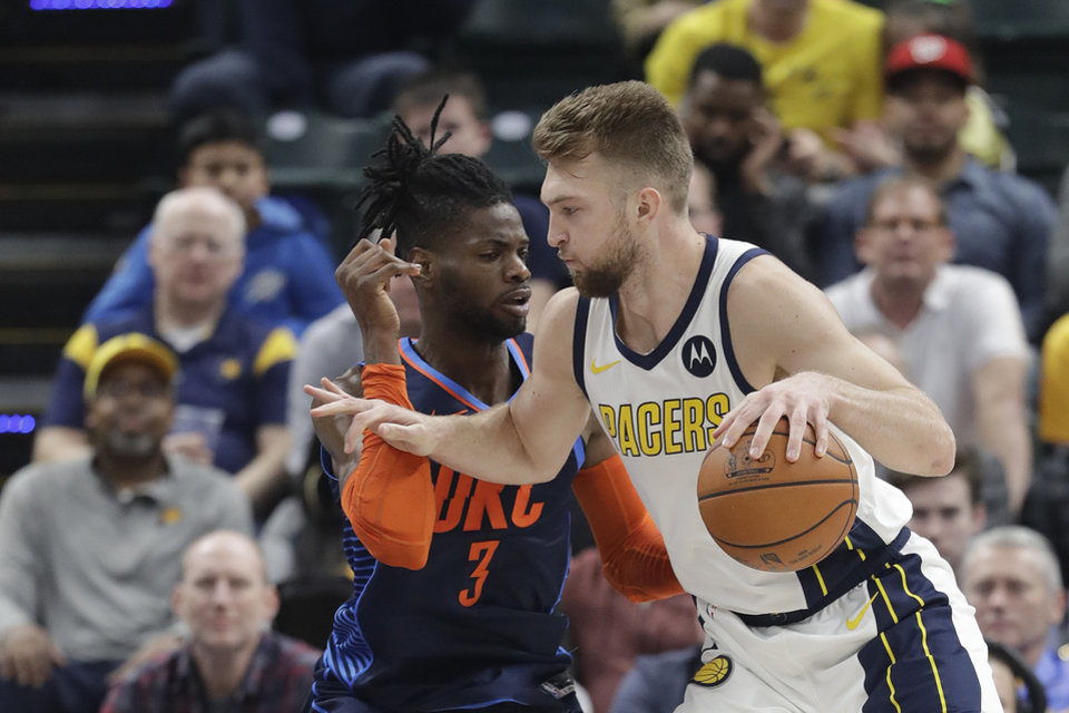 Photo - Indiana Pacers' Domantas Sabonis (11) goes to the basket against Oklahoma City Thunder's Nerlens Noel (3) during the first half of an NBA basketball game, Thursday, March 14, 2019, in Indianapolis. (AP Photo/Darron Cummings)