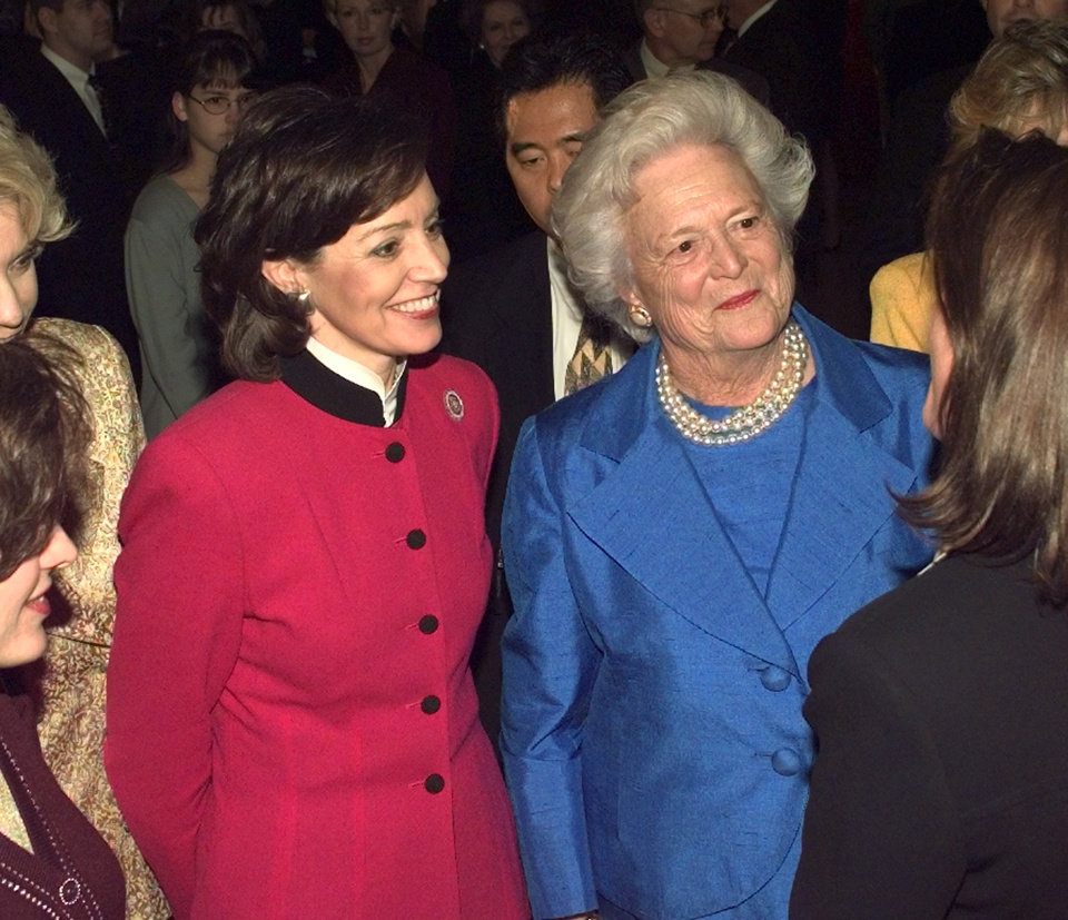 Photo - Oklahoma first lady Cathy Keating and Barbara Bush greeting supporters at the
