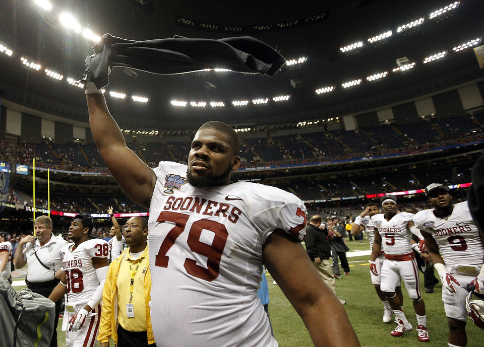Photo - Oklahoma's Daryl Williams (79) celebrates following the Sooner's win in  the NCAA football BCS Sugar Bowl game between the University of Oklahoma Sooners (OU) and the University of Alabama Crimson Tide (UA) at the Superdome in New Orleans, La., Friday, Jan. 3, 2014. Photo by Sarah Phipps, The Oklahoman