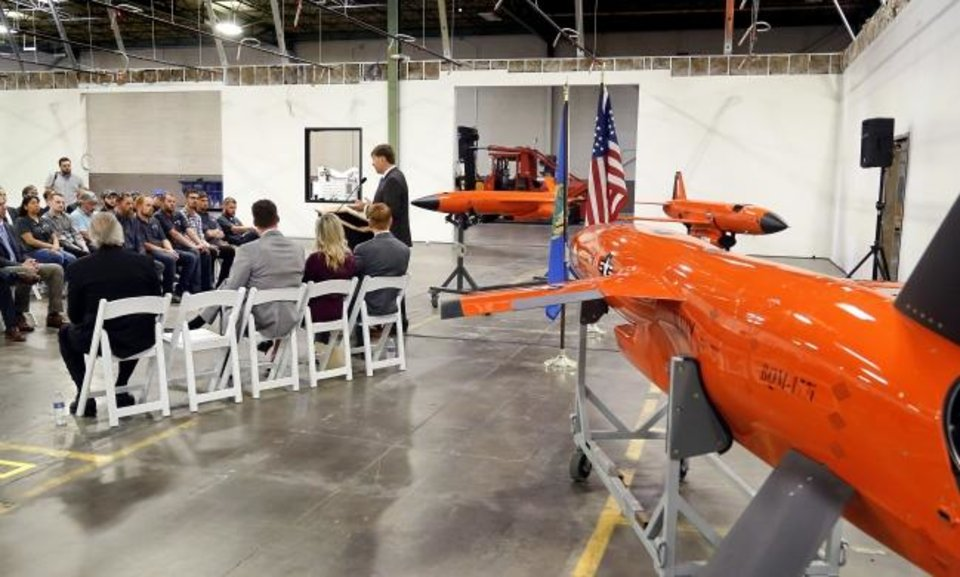 Photo -  Steve Fendley, President of Kratos Unmanned Systems Division, speaks Wednesday at  a reception at the Kratos Defense manufacturing facility in southwest Oklahoma City. [JIM BECKEL/THE OKLAHOMAN]