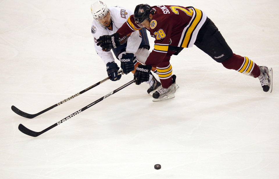 Oklahoma City\'s Garrett Stafford and Chicago\'s Stefan Schneider during the AHL game between the Oklahoma City Barons and the Chicago Wolves in Oklahoma City, Saturday, April 6, 2013. Photo by Sarah Phipps, The Oklahoman