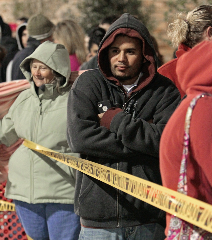 Mary Lou Grover and Albert Zoll wait in line at Target for the midnight opening on Black Friday, Nov. 25, 2011, in Moore, Okla. Photo by Steve Sisney, The Oklahoman