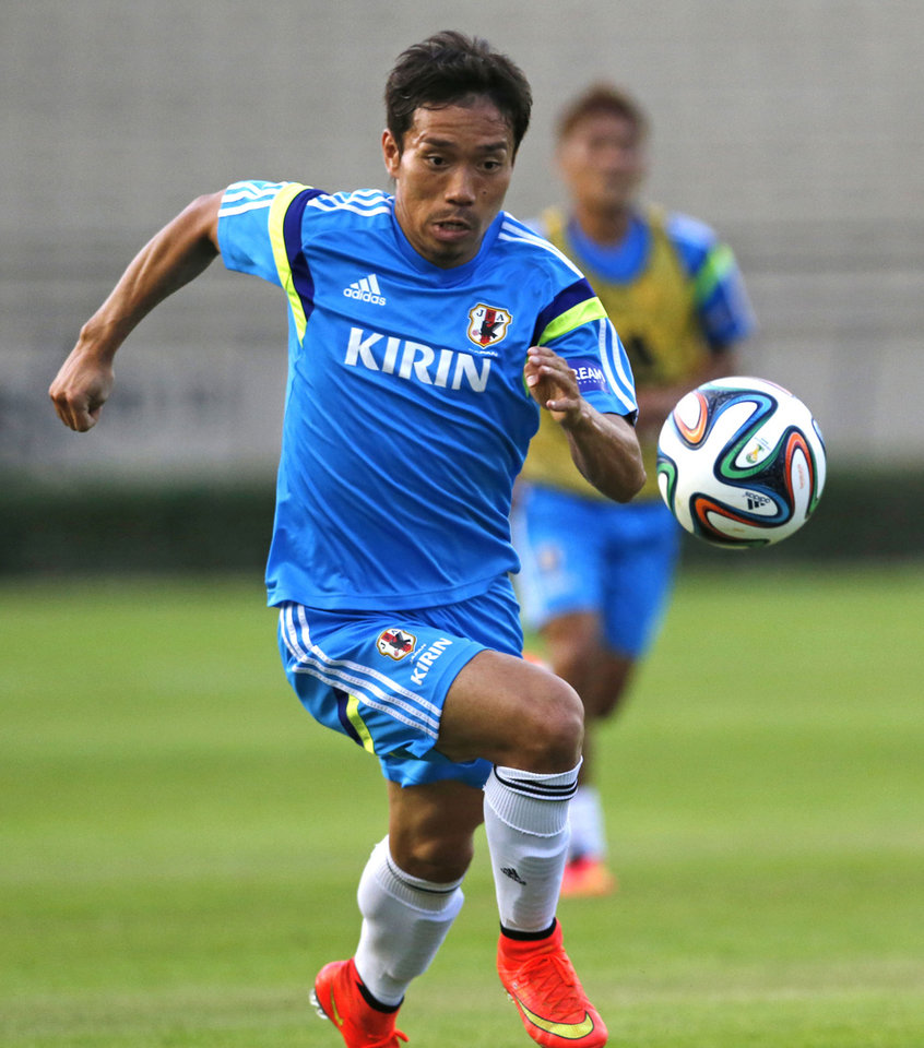 Photo - In this June 8, 2014 photo, Japan's Yuto Nagatomo controls the ball during a training session in Sorocaba, Brazil. Both at Inter and with Japan, Nagatomo's trademark is galloping down the right side in counter-attack and sending in pinpoint crosses, or even scoring himself. (AP Photo/Shuji Kajiyama)