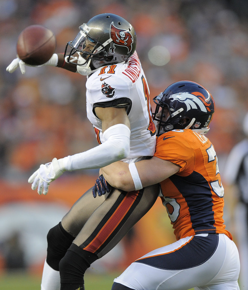 Photo - Denver Broncos free safety Jim Leonhard (36) breaks up a pass intended for Tampa Bay Buccaneers wide receiver Tiquan Underwood (11) in the third quarter of an NFL football game, Sunday, Dec. 2, 2012, in Denver. Denver won 31-23 to clinch the AFC West division. (AP Photo/Jack Dempsey)