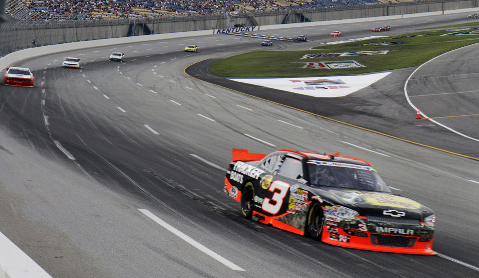 Photo -   Austin Dillon (3) heads into Turn 1 early in the NASCAR Nationwide Series auto race at Kentucky Speedway in Sparta, Ky., Friday, June 29, 2012. (AP Photo/Garry Jones)