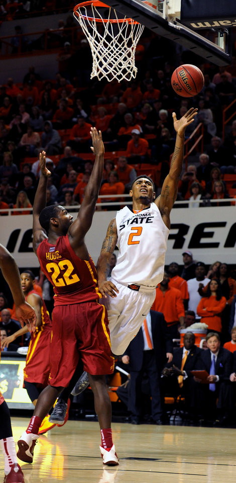 Photo - Oklahoma State Le'Bryan Nash (2) takes a shot over Iowa State forward Dustin Hogue (22) during an NCAA college basketball game in Stillwater, Okla., Monday, Feb. 3, 2014. Nash scored 26 points in the 98-97 win over Oklahoma State. (AP Photo/Brody Schmidt)