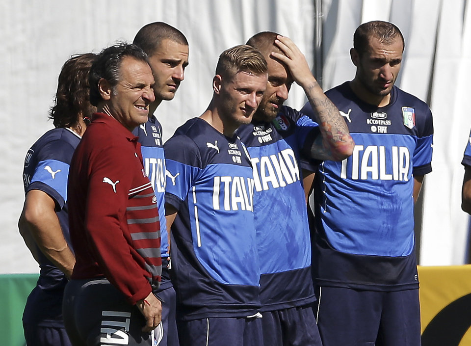 Photo - Italy's coach Cesare Prandelli, left, leads his team's training session in Mangaratiba, Brazil, Tuesday, June 17, 2014. Italy plays in group D at the soccer World Cup. (AP Photo/Antonio Calanni)