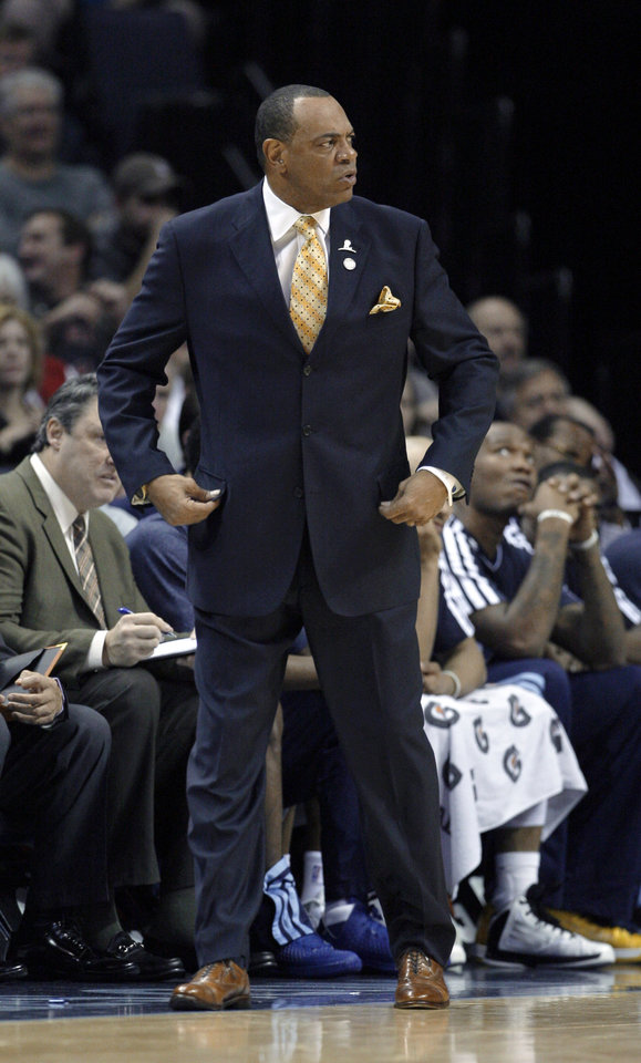 Photo - Memphis Grizzlies coach Lionel Hollins watches during the first half of an NBA basketball game against the Phoenix Suns in Memphis, Tenn., Tuesday, Dec. 4, 2012. The Grizzlies defeated the Suns 108-98 in overtime. (AP Photo/Danny Johnston)
