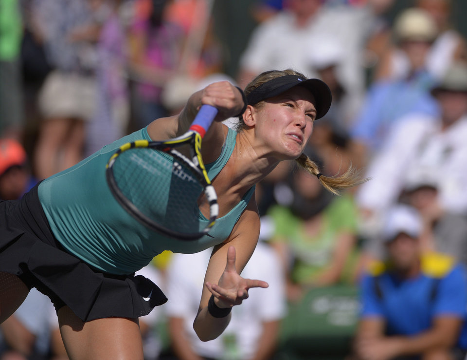 Photo - Eugenie Bouchard, of Canada, serves against Sara Errani, of Italy, in a match at the BNP Paribas Open tennis tournament on Sunday, March 9, 2014, in Indian Wells, Calif. Bouchard won the match 6-3, 6-3. (AP Photo/Mark J. Terrill)
