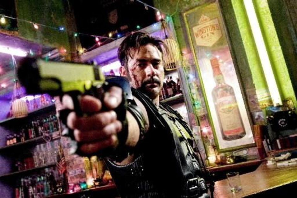 "In this movie still released by Warner Bros., Jeffrey Dean Morgan stars as The Comedian in a scene from the film, "" Watchmen."" (AP Photo/Warner Bros., Clay Enos)"