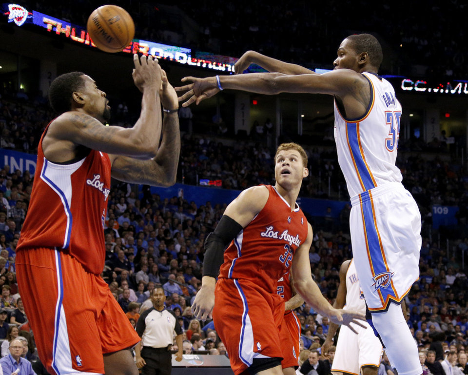 Photo - Oklahoma City's Kevin Durant (35) passes the ball between the Clippers DeAndre Jordan (6)  and Blake Griffin (32) during an NBA basketball game between the Oklahoma City Thunder and the Los Angeles Clippers at Chesapeake Energy Arena in Oklahoma City, Wednesday, Nov. 21, 2012. Photo by Bryan Terry, The Oklahoman