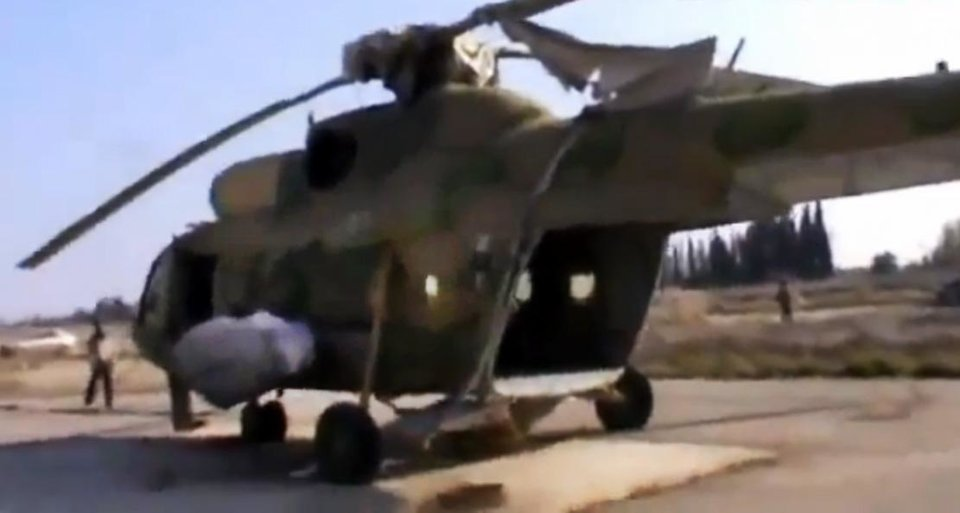 In this image taken from video obtained from the Ugarit News, which has been authenticated based on its contents and other AP reporting, Free Syrian Army fighters capture a helicopter at the Marj al-Sultan military air base in Damascus, Syria, on Wednesday, Nov. 28, 2012. (AP Photo/Ugarit News via AP video)