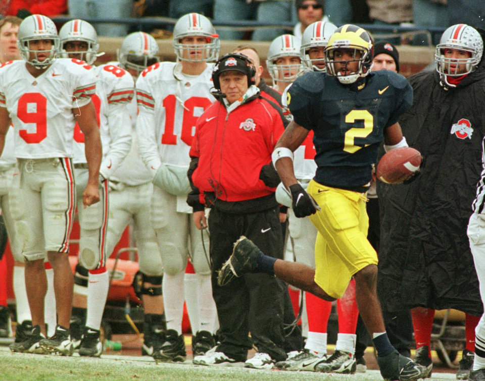 Photo - Michigan cornerback Charles Woodson in 1997. AP ARCHIVE PHOTO