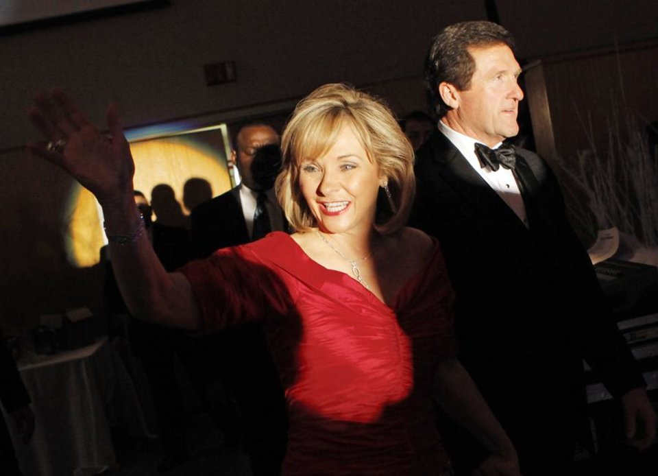 Gov. Mary Fallin enters the ballroom with her husband Wade Christensen during Fallin\'s inaugural ball at the National Cowboy and Western Heritage Museum in Oklahoma City, Monday, January 10, 2011. Photo by Nate Billings, The Oklahoman