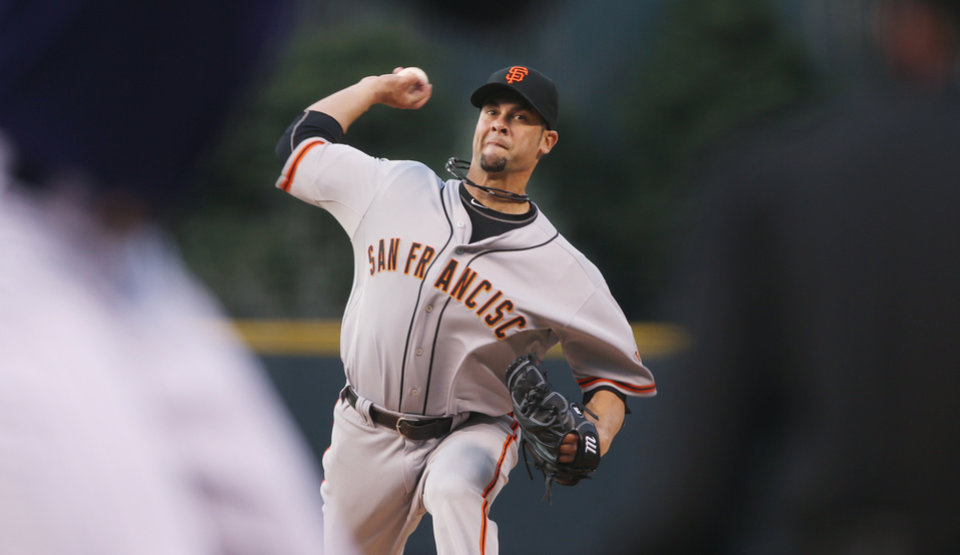 Photo - San Francisco Giants starting pitcher Ryan Vogelsong works against the Colorado Rockies in the first inning of a baseball game in Denver on Monday, April 21, 2014. (AP Photo/David Zalubowski)