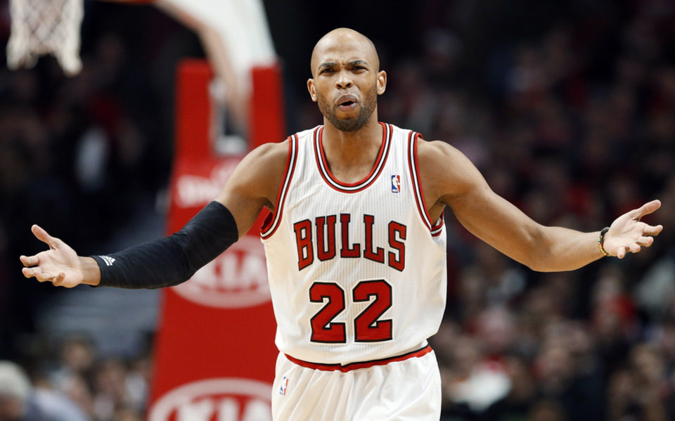 Photo - Chicago Bulls forward Taj Gibson reacts to a call during the first half of an NBA basketball game against the Phoenix Suns in Chicago on Saturday, Jan. 12, 2013. (AP Photo/Nam Y. Huh)