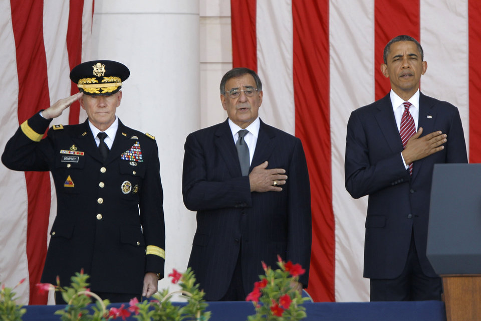 Photo -   President Barack Obama, right, Defense Secretary Leon Panetta, center, and Chairman of the Joint Chiefs of Staff Gen. Martin Dempsey, stand during the singing of the National Anthem at the Memorial Day Observance at the Memorial Amphitheater at Arlington National Cemetery, Monday, May 28, 2012. (AP Photo/Charles Dharapak)