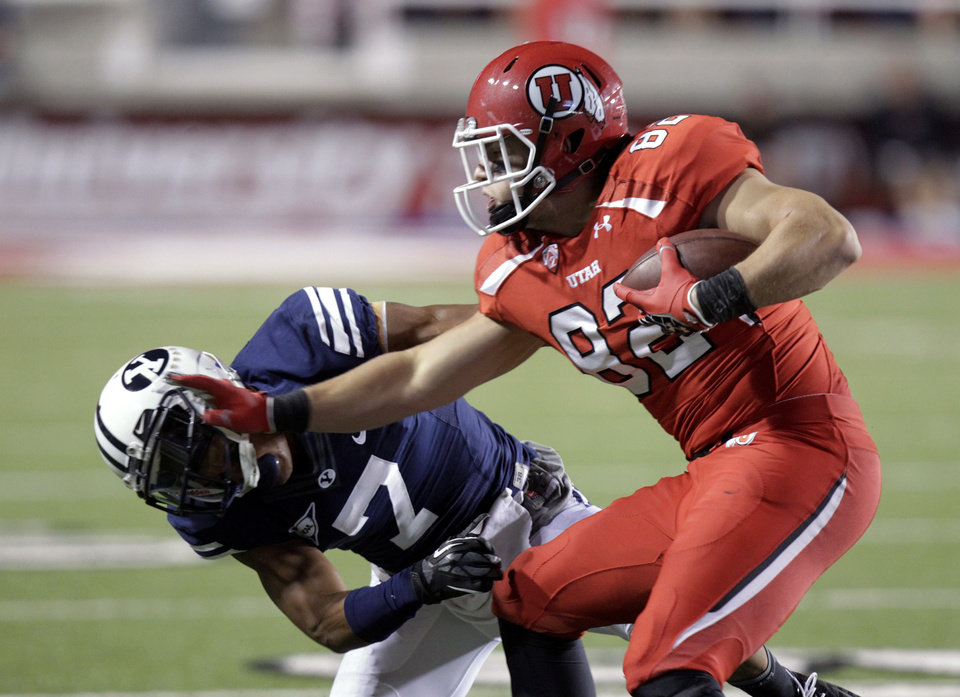 Photo -   Utah tight end Jake Murphy (82) stiff-arms BYU defensive back Preston Hadley (7) during the second quarter of an NCAA college football game Saturday, Sept. 15, 2012, in Salt Lake City. (AP Photo/Rick Bowmer)
