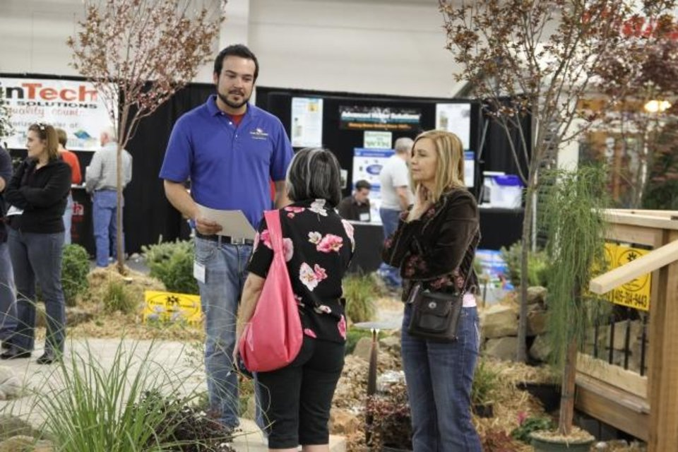 Photo -  An exhbitor talks with attendees at a previous Oklahoma City Spring Remodel & Landscape Show. [PHOTO PROVIDED]