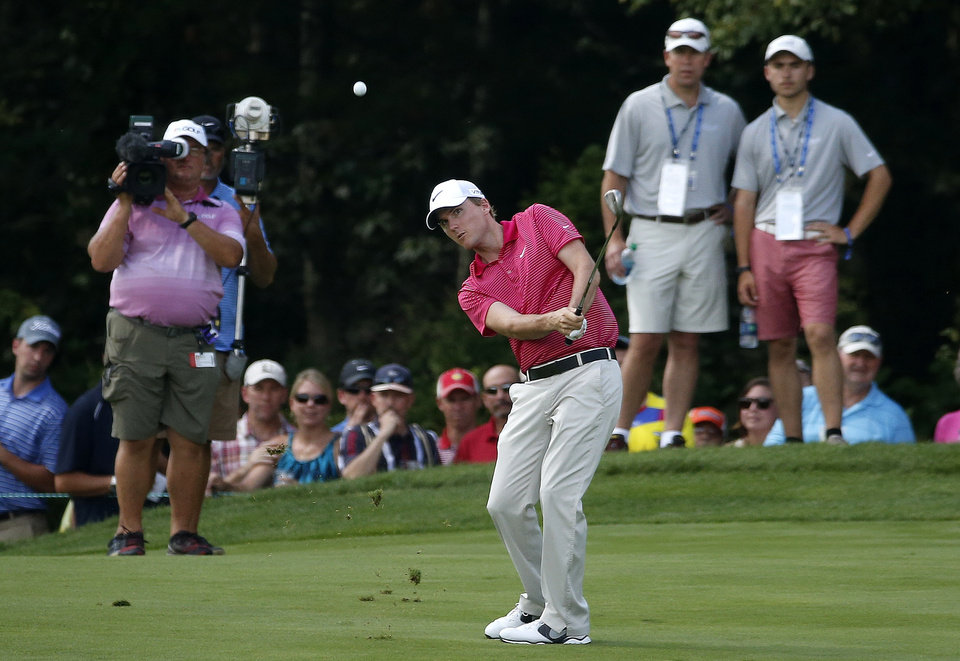 Photo - Russell Henley hits his approach shot from the second fairway during the final round of the Deutsche Bank Championship golf tournament in Norton, Mass., Monday, Sept. 1, 2014. (AP Photo/Michael Dwyer)