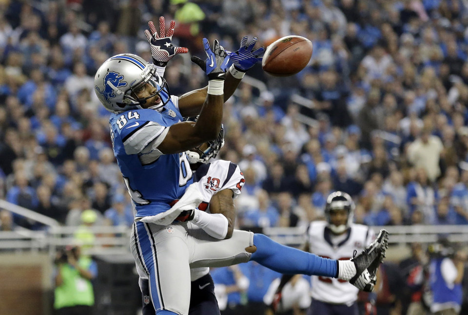 Houston Texans defensive back Brice McCain, back, knocks a pass out of the hands of Detroit Lions wide receiver Ryan Broyles (84) during the first quarter of an NFL football game at Ford Field in Detroit, Thursday, Nov. 22, 2012. (AP Photo/Paul Sancya) ORG XMIT: DTF104