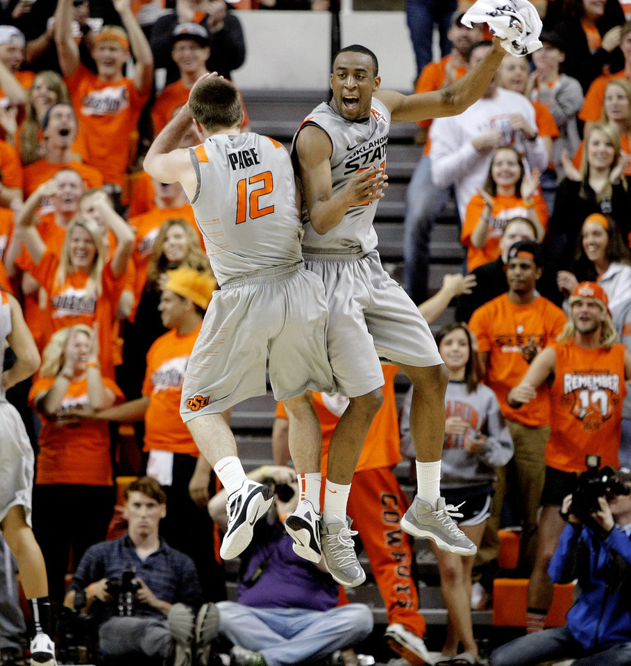 Photo - Oklahoma State's Keiton Page (12) and Markel Brown (22) celebrate during an NCAA college basketball game between Oklahoma State University (OSU) and the University of Texas (UT) at Gallagher-Iba Arena in Stillwater, Okla., Saturday, Feb. 18, 2012. Oklahoma State won 90-78. Photo by Bryan Terry, The Oklahoman