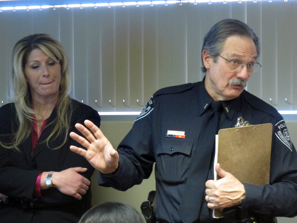 Photo - Anchorage Police Detective Monique Doll, left, and spokesman Lt. Dave Parker speak during a news conference Tuesday, Dec. 4, 2012, in Anchorage, Alaska. Authorities released more information of the Feb. 1, 2012, abduction of Samantha Koenig, 18, from a coffee stand in Anchorage. Police said Israel Keyes confessed to sexually assaulting and strangling the woman, and left her body in a shed at his Anchorage home while he went on a cruise. The FBI says he returned two weeks later, dismembered her body and disposed of in a frozen lake north of Anchorage. He was captured by authorities in Texas in March, and was found dead in his Anchorage jail cell Sunday, apparently by suicide. (AP Photo/Mark Thiessen)