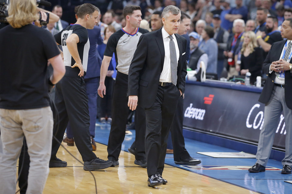 Photo - Oklahoma City coach Billy Donovan walks towards the bench after meeting with officials before an NBA basketball game between the Oklahoma City Thunder and the Utah Jazz was postponed at Chesapeake Energy Arena in Oklahoma City, Wednesday, March 11, 2020. [Bryan Terry/The Oklahoman]