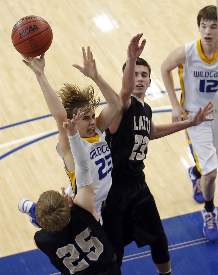 Chouteau\'s Jordon Shive shoots in between Latta\'s Trent Storts (25) and Brady Johnson (23) during the 2A boys high school basketball game in the semifinals of the state tournament between Latta and Chouteau at Oklahoma City University in Oklahoma City, Friday, March 8, 2013. Photo by Sarah Phipps, The Oklahoman