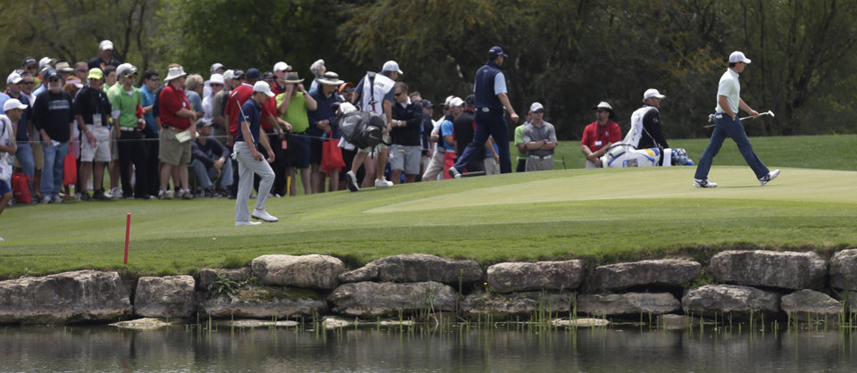 Rory McIlroy, right, of Northern Ireland, walks on to the third green during the second round of the Texas Open golf tournament, Friday, April 5, 2013, in San Antonio.  (AP Photo/Eric Gay)