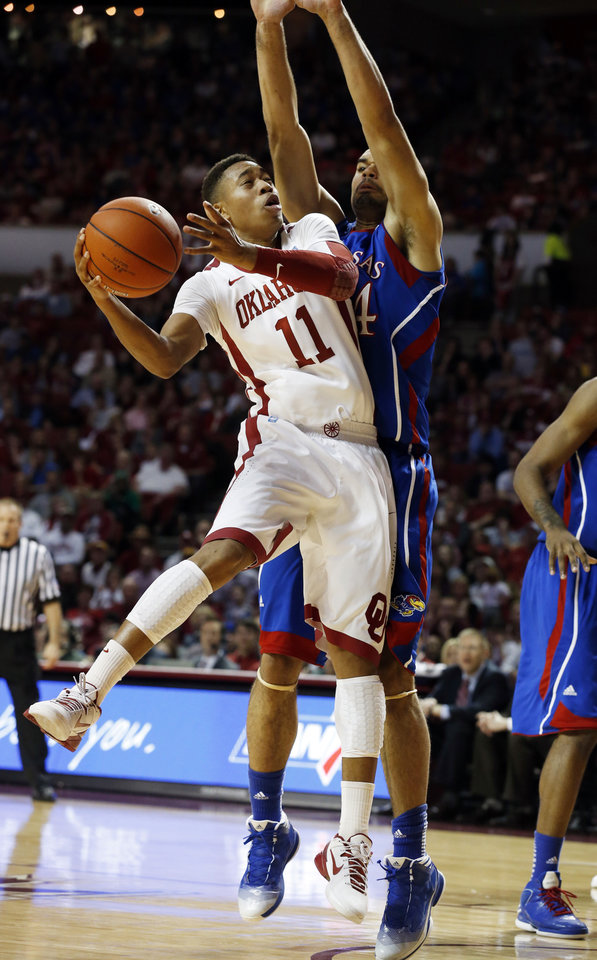 Oklahoma\'s Isaiah Cousins (11) shoots guarded by Kansas\' Perry Ellis (34) during the second half as the University of Oklahoma Sooners (OU) defeat the Kansas Jayhawks (KU) 72-66 in NCAA, men\'s college basketball at The Lloyd Noble Center on Saturday, Feb. 9, 2013 in Norman, Okla. Photo by Steve Sisney, The Oklahoman