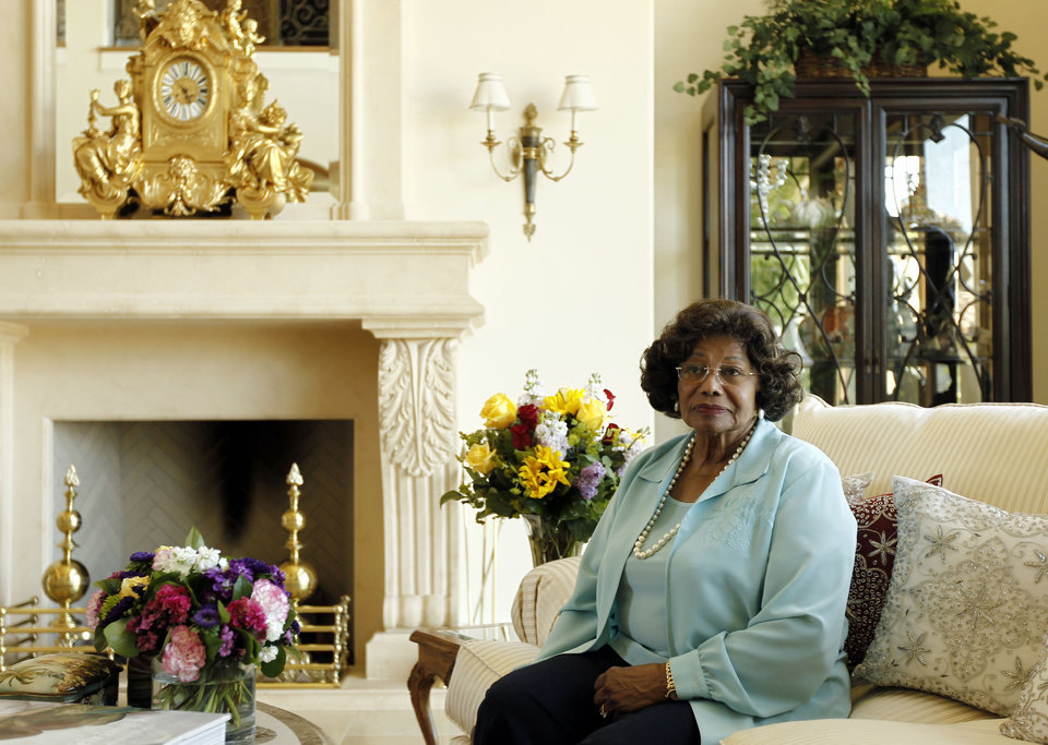Photo - FILE - In this April 27, 2011 file photo, Katherine Jackson poses for a portrait at home in Calabasas, Calif.  Michael Jackson's will left his mother, Katherine, as the primary caretaker of his children, Prince, Paris and Blanket. The four receive a stipend and the estate pays for the children's education, vacations, and a mansion in the celebrity enclave of Calabasas. Through the end of 2012, Jackson's estate paid nearly $20 million to support his mother and children.  (AP Photo/Matt Sayles, file)