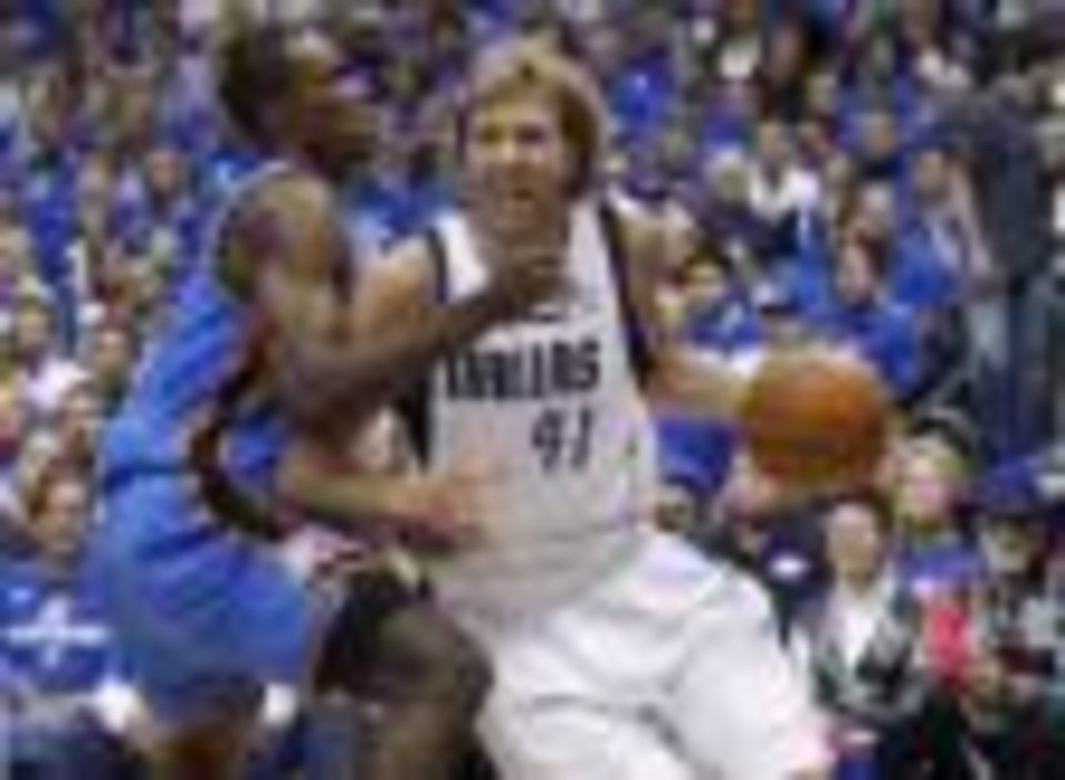 Dallas Mavericks forward Dirk Nowitzki, right, already has proven himself as an NBA great.