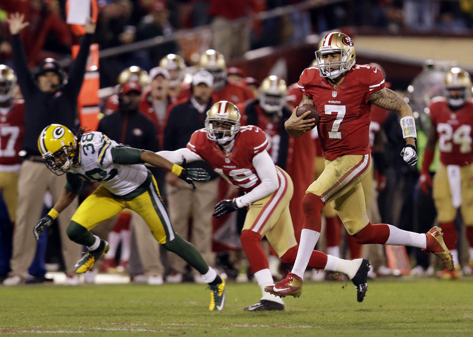 San Francisco 49ers quarterback Colin Kaepernick (7) runs for a 56-yard touchdown against the Green Bay Packers during the third quarter of an NFC divisional playoff NFL football game in San Francisco, Saturday, Jan. 12, 2013. (AP Photo/Marcio Jose Sanchez) ORG XMIT: FXP130