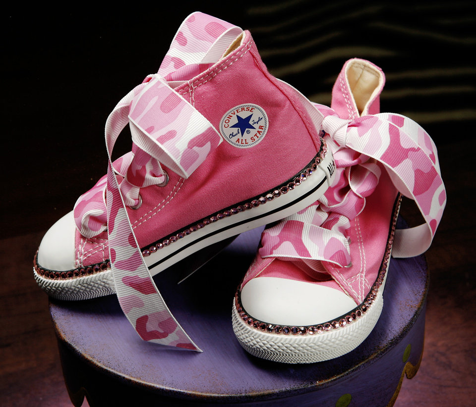 "Converse shoes by ""It's A Girl Thing"", stoned with Swarovski crystals, are featured among items in new upscale children's clothing store, Funky Monkey, 14101 N. May Ave on Tuesday,  Feb. 26, 2008.  BY JIM BECKEL, THE OKLAHOMAN"