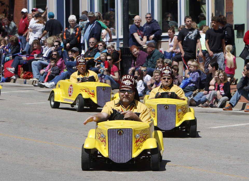 Photo - Shriners drive their mini-cars in the 89ers Day Parade in Guthrie, OK, Saturday, April 20, 2013,  By Paul Hellstern, The Oklahoman