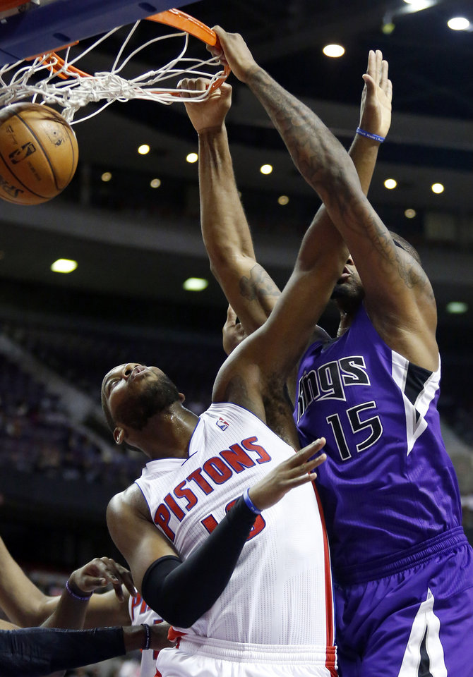 Sacramento Kings center DeMarcus Cousins (15) dunks over Detroit Pistons center Greg Monroe, left, in the first half of an NBA basketball game Tuesday, Jan. 1, 2013, in Auburn Hills, Mich. (AP Photo/Duane Burleson)