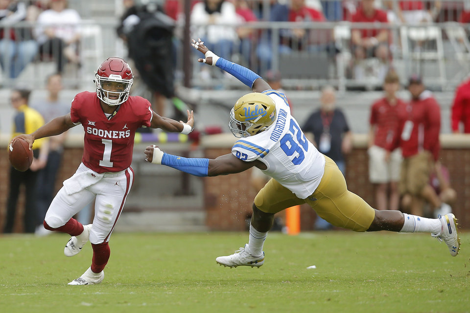 Photo - Oklahoma's Kyler Murray (1) scrambles past UCLA's Osa Odighizuwa (92) during a college football game between the University of Oklahoma Sooners (OU) and the UCLA Bruins at Gaylord Family-Oklahoma Memorial Stadium in Norman, Okla., Saturday, Sept. 8, 2018. Oklahoma won 49-21. Photo by Bryan Terry, The Oklahoman