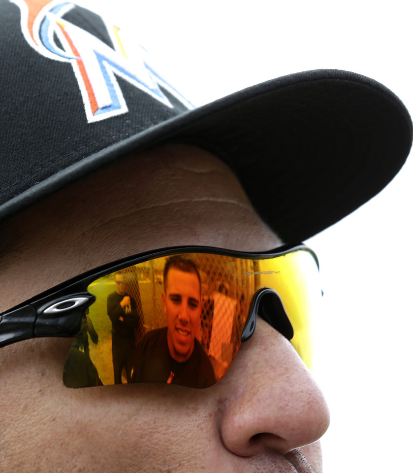 Miami Marlins non-roster invitee pitcher Jose Fernandez is reflected in the sunglasses of Marlins minor league pitching coordinator Wayne Rosenthal during an exhibition spring training baseball game against the St. Louis Cardinals, Thursday, Feb. 28, 2013, in Jupiter, Fla. (AP Photo/Julio Cortez)