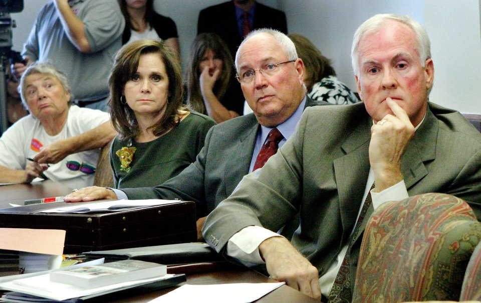 LEGISLATIVE HEARING: Three DHS commissioners sit together at a table answering questions from lawmakers. From left are, Linda English Weeks, Richard DeVaughn and Brad Yarbrough. Photo by Jim Beckel, The Oklahoman Archives.