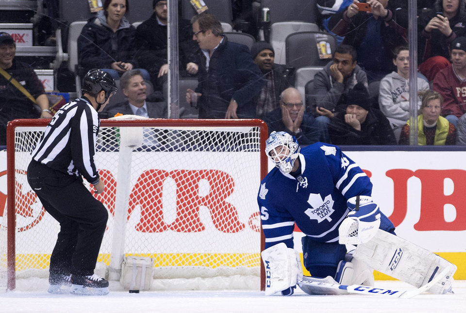 Photo - Toronto Maple Leafs goalie Jonathan Bernier reacts after mishandling the puck and allowing a New York Islanders goal during second period of an NHL hockey game in Toronto, Tuesday, Jan. 7, 2014. (AP Photo/The Canadian Press, Nathan Denette)
