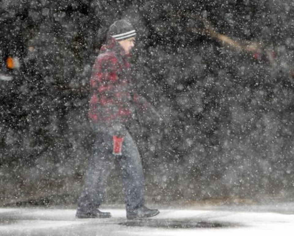 Snow falls in downtown Oklahoma City, OK, Friday, December 28, 2012, By Paul Hellstern