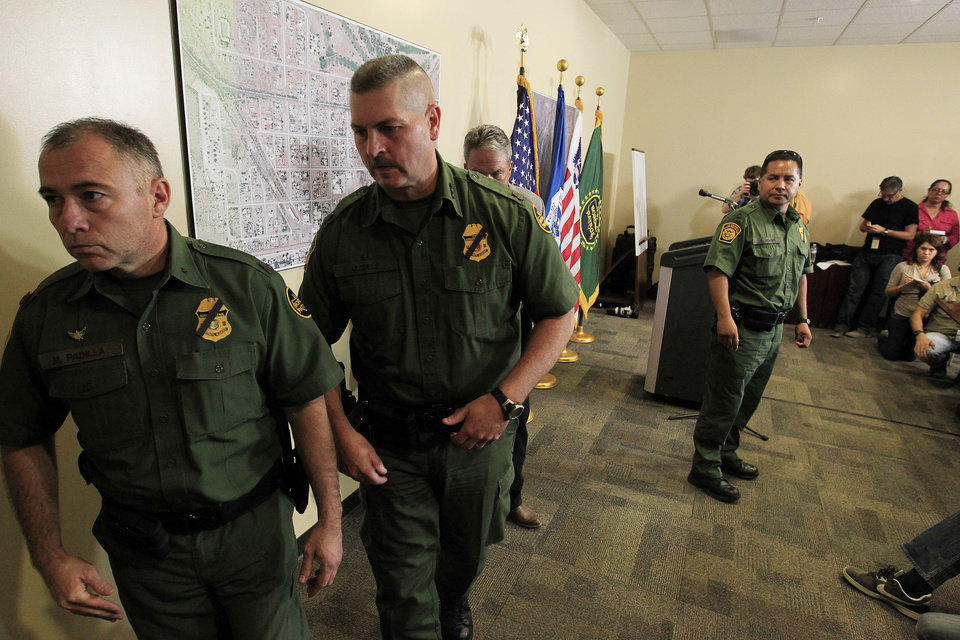 Photo -   Hours after a U.S. Border Patrol agent was shot and killed, and one other was shot and injured, Manuel Padilla, left, U.S. Border Patrol Acting Chief Patrol Agent Tucson Sector, and Jeffrey Self, U.S. Border Protection Joint Field Command Arizona, leave after a news conference at the U.S. Customs and Border Protection Brian A. Terry Border Patrol Station Tuesday, Oct. 2, 2012, in Bisbee, Ariz.(AP Photo/Ross D. Franklin)