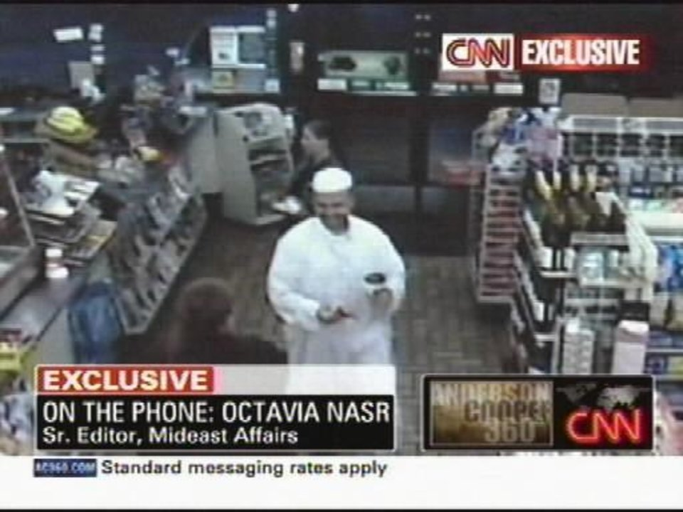 Photo - A frame grab from a security video provided by CNN shows Maj. Nadal Malik Hasan in a convenience store in Killeen, Texas early Thursday morning, Nov. 5, 2009. Hasan was identified by authorities as the man who shot and killed people at  Fort  Hood, Texas, in the worst mass shooting ever at a military base in the United States. (AP Photo/CNN)