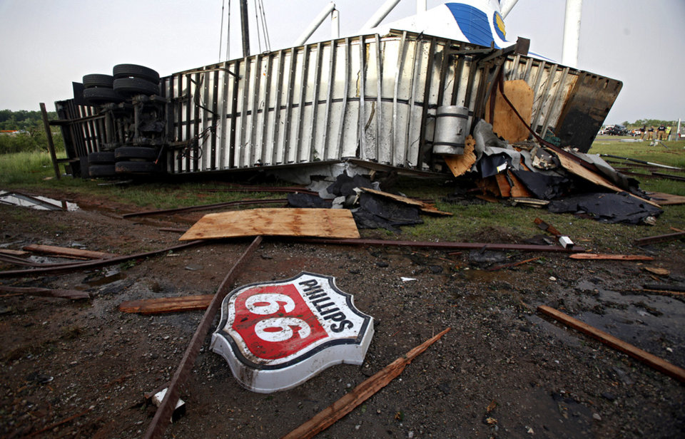 A semi truck is wrapped around a pole on its side at the Anderson Travel Plaza after a tornado damaged the area around I-40 and Choctaw Road on Monday, May 10, 2010, in Oklahoma City, Okla.  Photo by Chris Landsberger, The Oklahoman