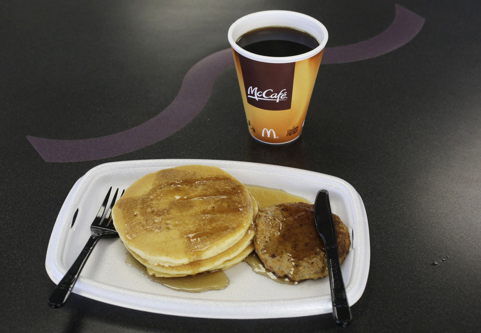 Photo - A McDonald's breakfast is arranged for an illustration Thursday, Feb. 14, 2013 at a McDonald's restaurant in New York. The pancakes and sausage are served on a foam tray and coffee is served in a foam cup. New York Mayor Michael Bloomberg, who has taken on smoking, sugary drinks and salt, talked about banning food packaging made from polystyrene foam from stores and restaurants in his annual State of the City address on Thursday. (AP Photo/Mark Lennihan)