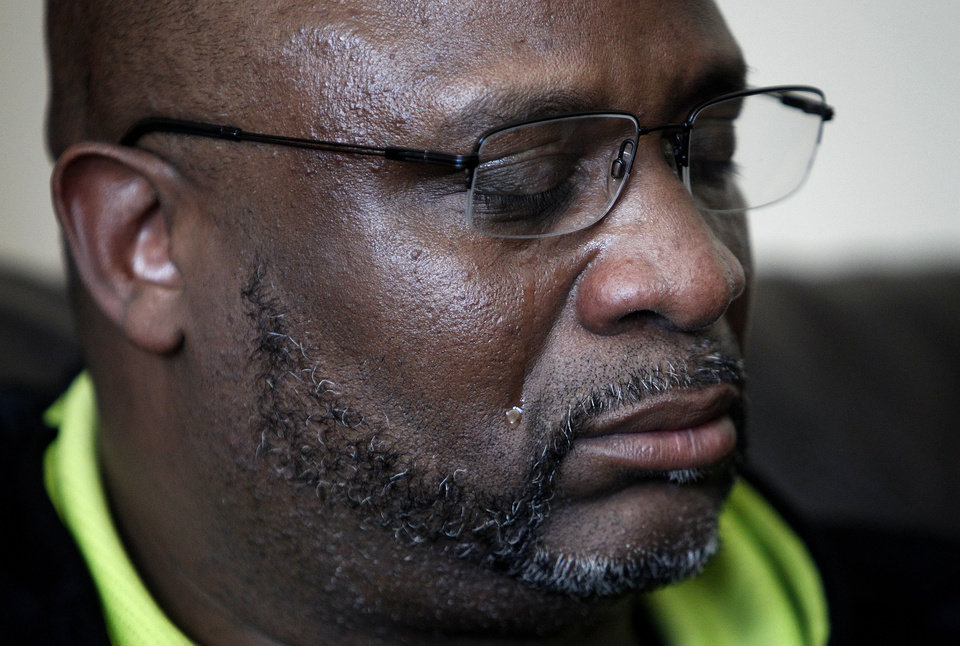 Kenneth Cherry Sr. cries as he speaks during a news conference in Las Vegas on Saturday, Feb. 23, 2013, regarding the death of his son Kenny Cherry. Kenneth Cherry Jr. was driving a Maserati that was peppered by gunfire before it sped through a red light and smashed into a taxi driven by Michael Boldon carrying passenger Sandra Sutton-Wasmund. All three involved in the crash were killed and the  coroner said Cherry died of a gunshot to the chest. (AP Photo/Las Vegas Review-Journal, John Locher)
