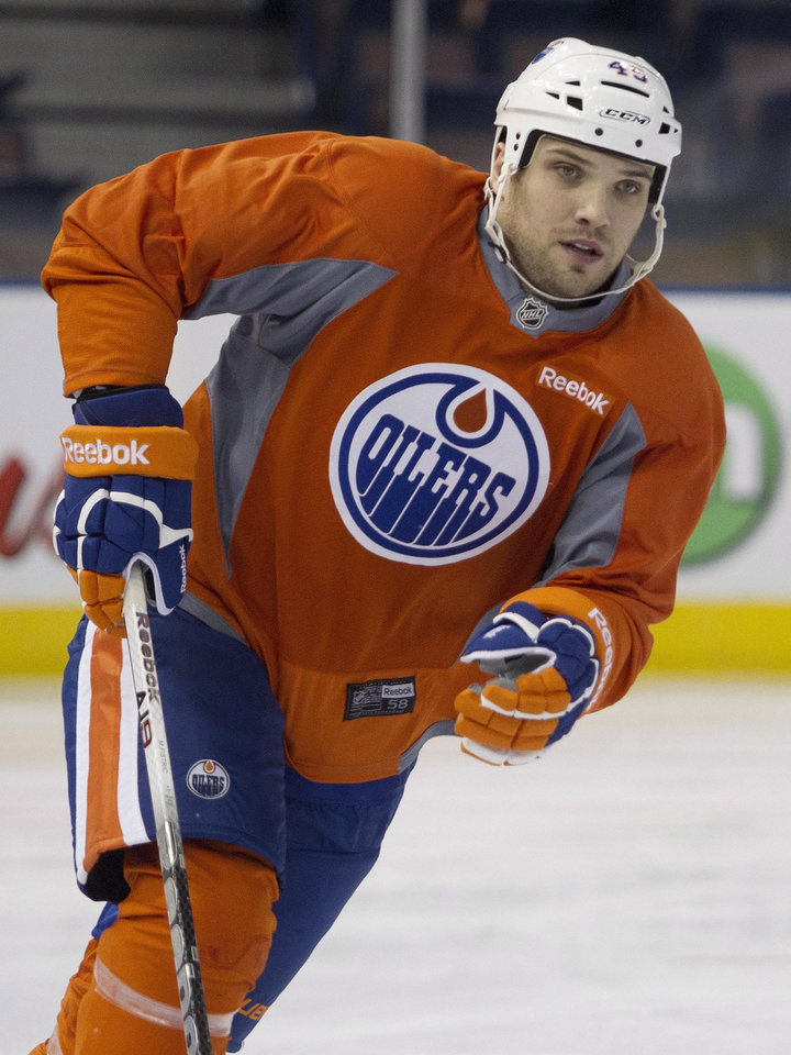 Photo - Edmonton Oilers defenseman Mark Fistric skates during the NHL hockey training camp in Edmonton, Alberta, on Tuesday, Jan. 15, 2013. (AP Photo/The Canadian Press, Jason Franson)